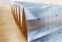 Solid accordion-folded underlay with vapor barrier